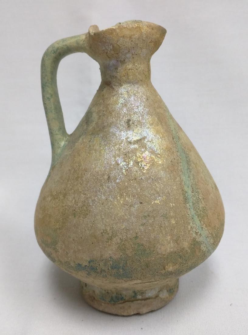 A Kashan Turquoise Glazed Flaring Pottery Jug
