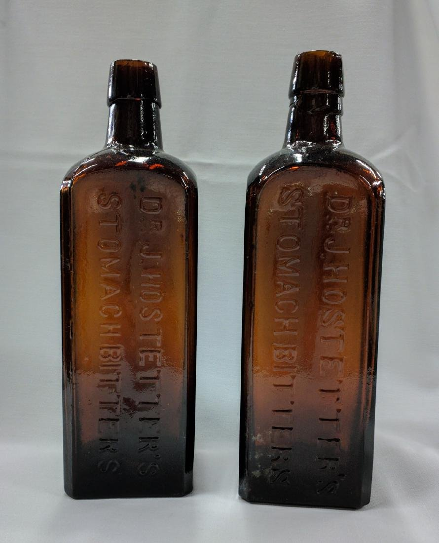 Two American Medicines Glass Bottles