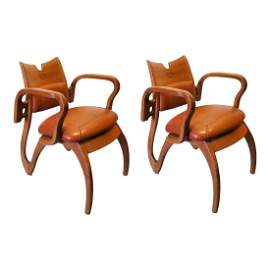 Pair of Scandinavian Leather Ornate Arm Chairs