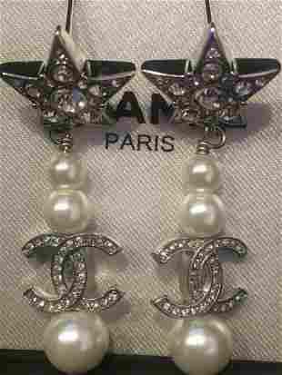 Chanel Pair Pearl Star Drop earrings