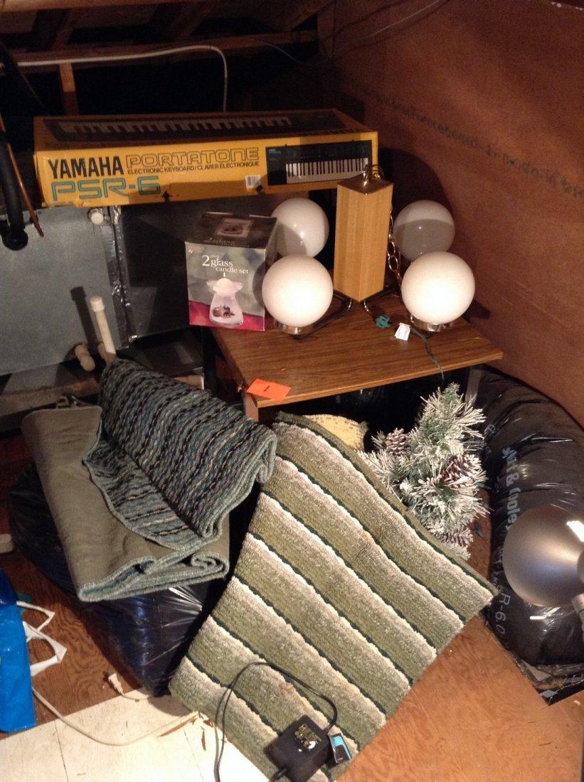 Yamaha Portatone, light fixture, rugs