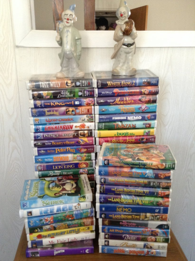 Large of Lot of Disney VHS Tapes & 2 Clown Statues