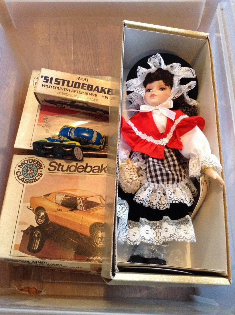 Vintage models; tin wind up cars and dolls