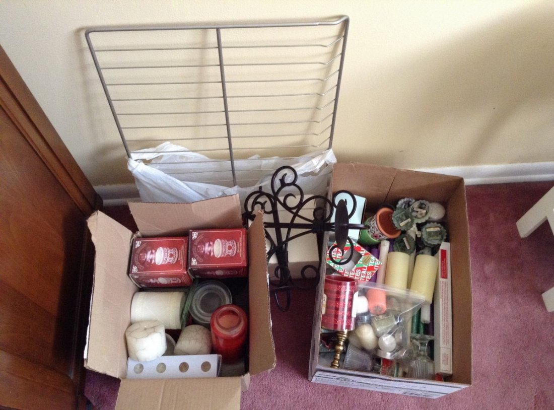 2 boxes of candles and wall sconsces