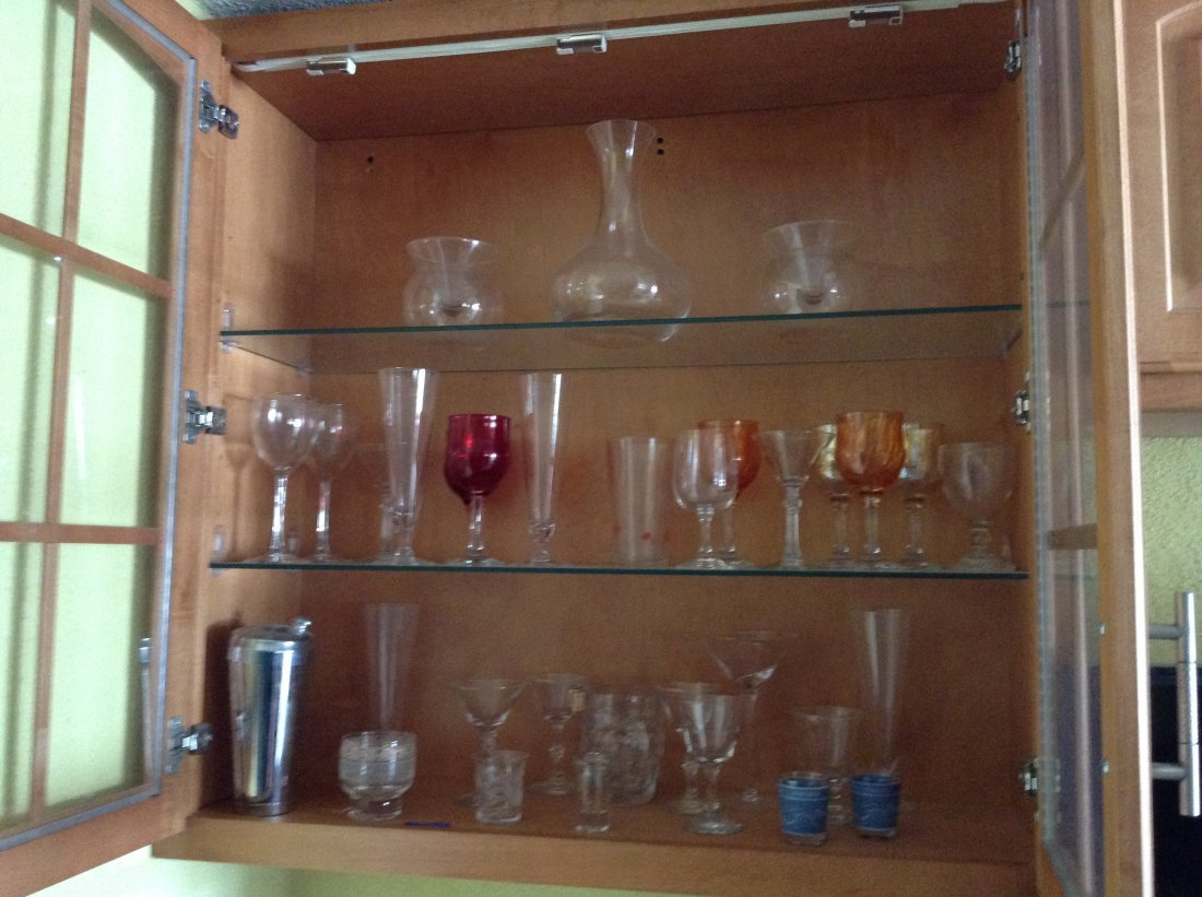 Cabinet full of vintage crystal wine glasses