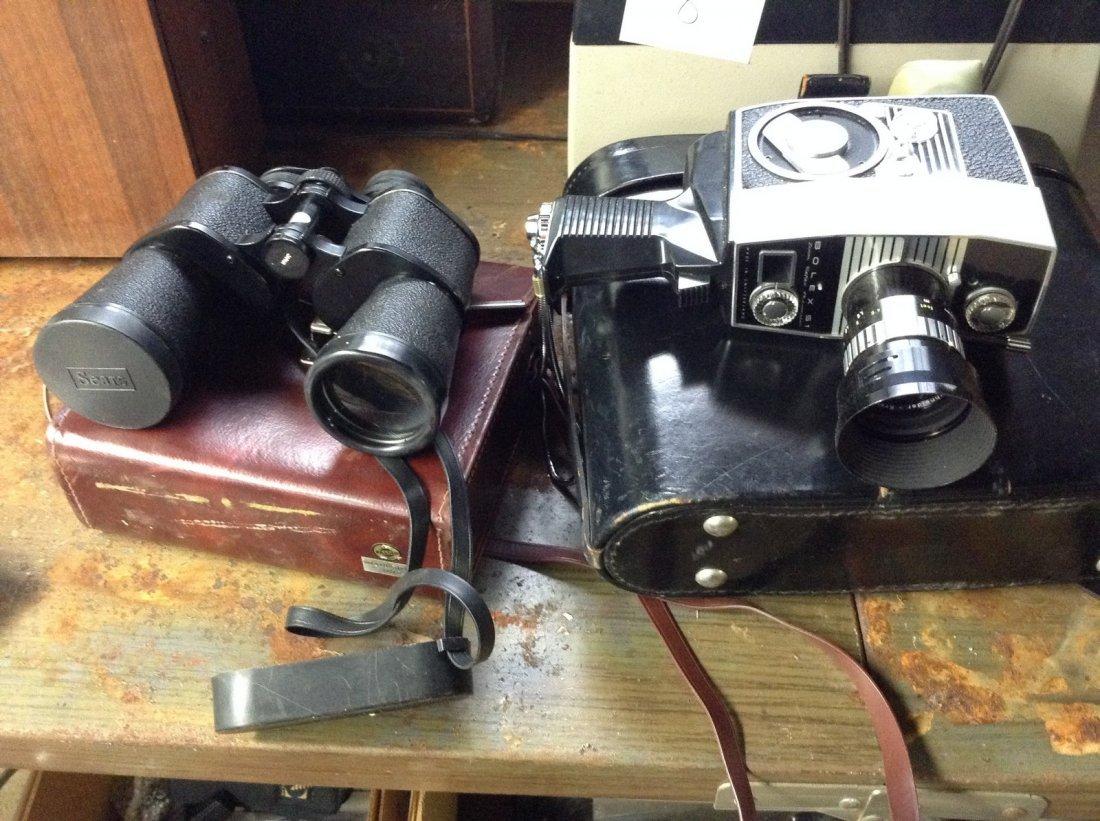 Movie camera; binoculars; film dupicator