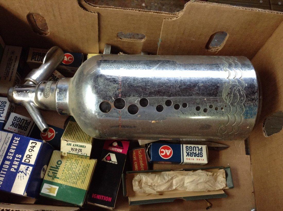 Auto parts and seltzer bottle