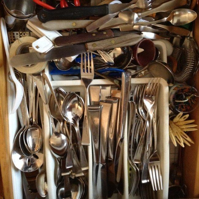 Drawer full of Goraham Midcentury utensils