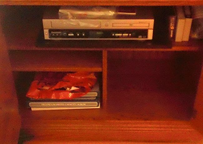 Panasonic DVD/ VHS player with booklets; photo albums