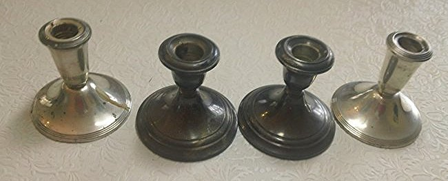 4 weighted Sterling Candle stick Holders