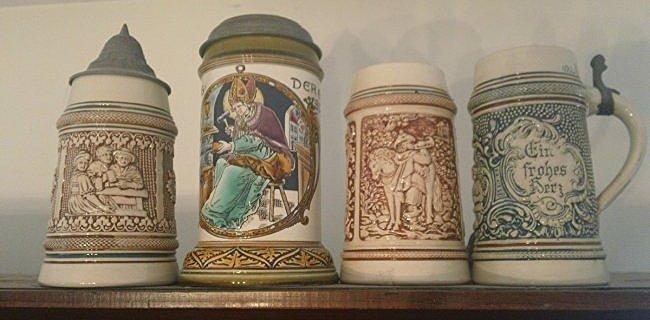 4 German marked Beer Steins; One is a Mettlach
