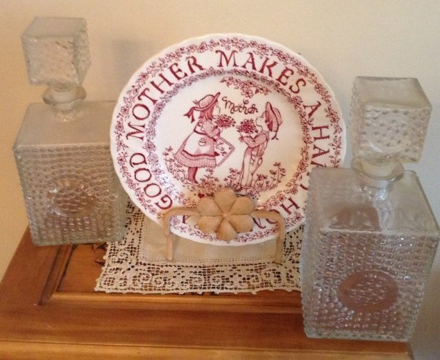 a pair of crystal decanders and display plate
