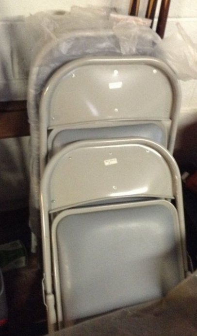 4 new paded metal folding chairs