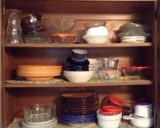 Misc glassware in kitchen cabinet