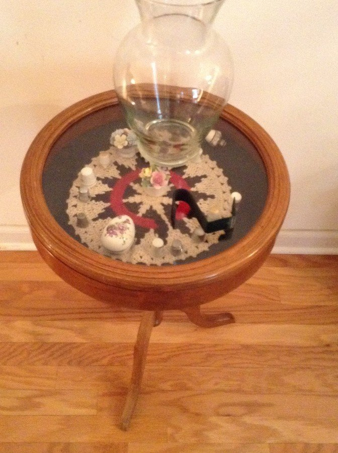 Small glass top table with contents