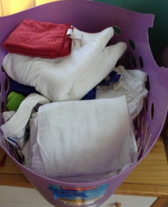 Basket of linens - wash clothes, towels, gauze blankets