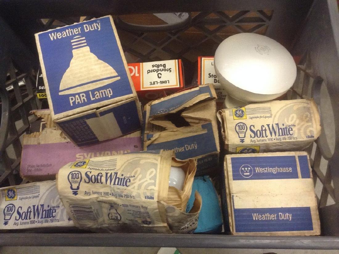 Milk crate full of light bulbs