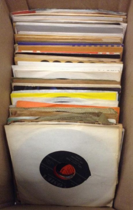 Box of 1950's, 45's with sleeves