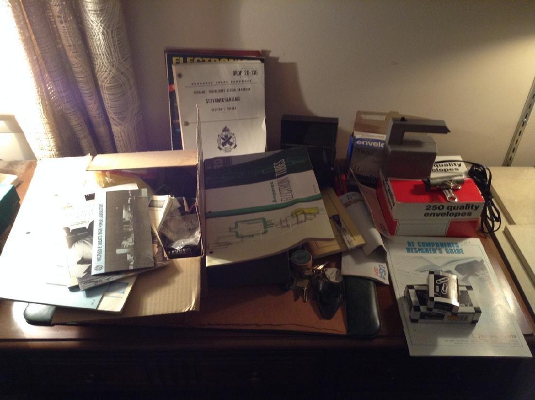 Contents Top of Desk with Vintage War Ordnance books &