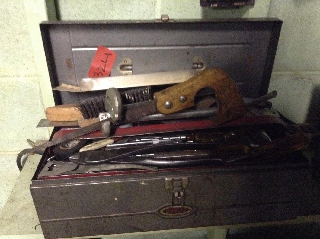 Vintage toolbox loaded with tools