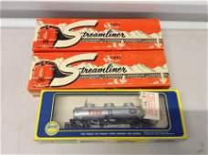 HO train car and two unbuilt HO models
