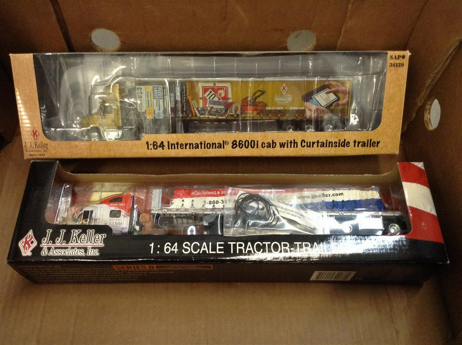 lot of two diecast tractor trailers - JJ Keller