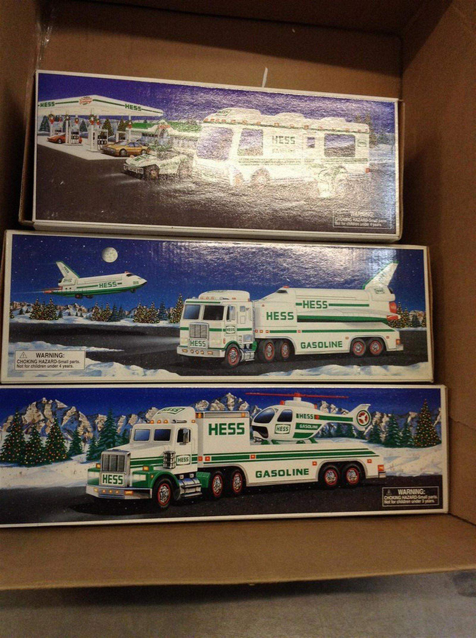 lot of three Hess trucks