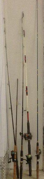 lot of vintage fishing poles