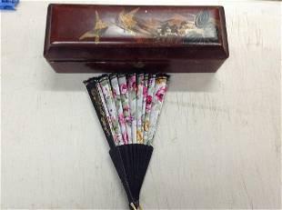 oriental jewelry box and fan