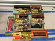 large lot of ho train cars in the boxes