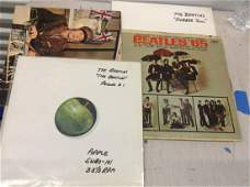 lot of Beatles records and inserts