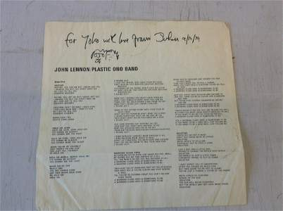 signed guaranteeing the signature john Lennon and the