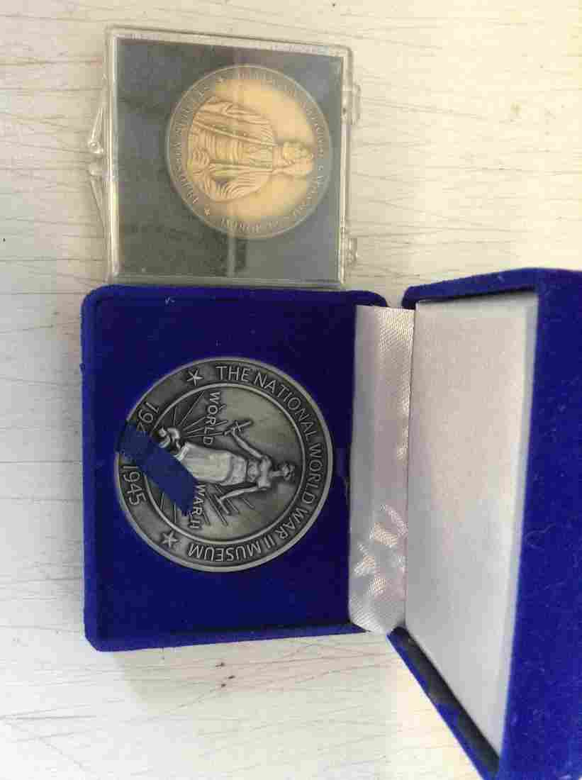 WWII Museum token & Jefferson Memorial Token