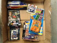 lot of hot wheels, nascar and other cars in the package