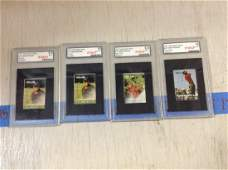 lot of four graded tiger woods stamps
