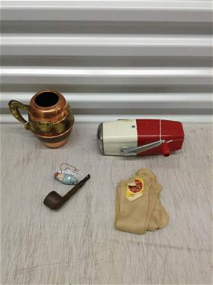 Vintage ice cream crusher, old lady stockings, pipe and