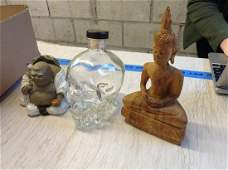 Empty Crystal Head Vodka Bottle and Two Buddhas