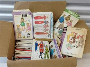 Box full of vintage sewing patterns