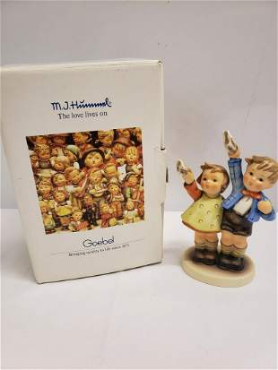 Hummel boy and girl playing statue new in box