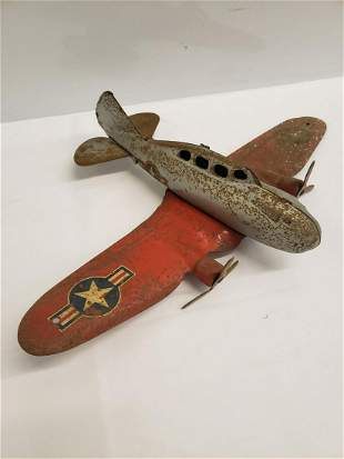 Antique metal military toy airplane