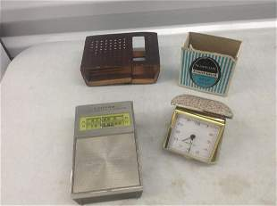 Lloyd's Solid State Radio and Westclox Travel clock in