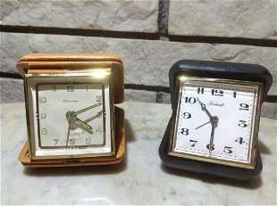 Two West German Travel Clocks one with Genuine Leather