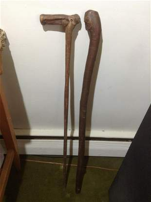 Two Hand Carved Walking Sticks