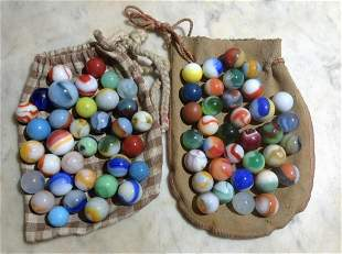 Two Pouches full of very early marbles with shooter