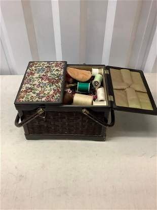 lot of sewing supplies in basket