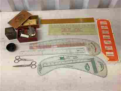 lot of sewing supplies and dressmaking rulers