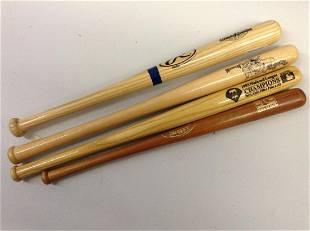 Lot of four miniature baseball bats one signed