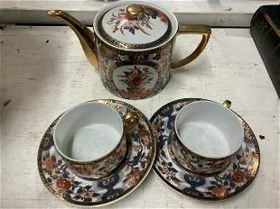 Teapot with Two Cups and Saucers