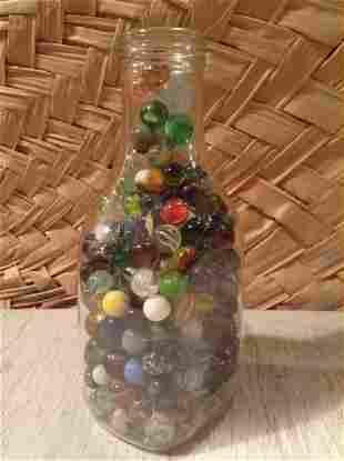 "Milk Bottle Full of early Marbles 9"" tall"