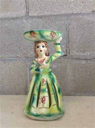 Hand painted ceramic woman with small plate on top and